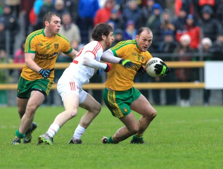 Colm McFadden in possession against Ronan McNamee of Tyrone.