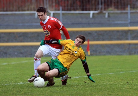 Darach O'Connor is fouled by Tyrone 'keeper Niall Morgan for a penalty in the first half.