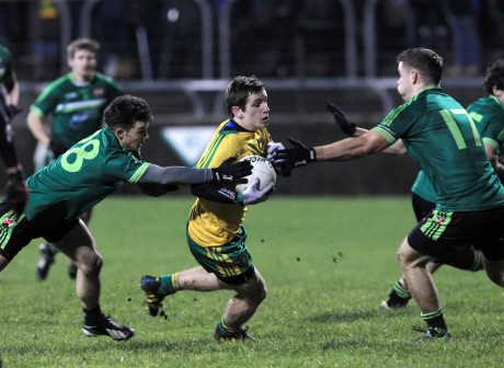 Donegal's Darach O'Connor is challenged during the match against Queen's University.