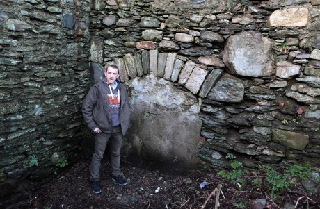 Donnan Harvey pictured at the fireplace believed to be built and used in the 17th century.