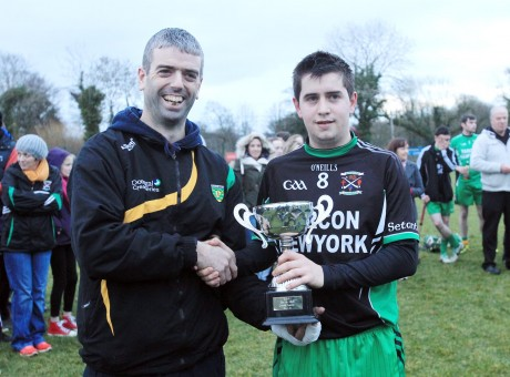 Colm Breathnach presenting Setanta captain Brendan Tourish with the Cup.