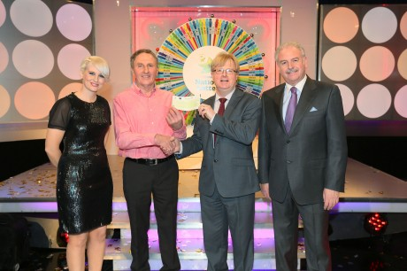 Pictured at the presentation of winning cheques were, from left to right: Sinead Kennedy, game show co-host; Frank McDaid, the winning player; Eddie Banville, Head of Marketing, The National Lottery and Marty Whelan, game show co-host. The winning ticket was bought from EuroSpar, Newtowncunningham, Picture: Mac Innes Photography