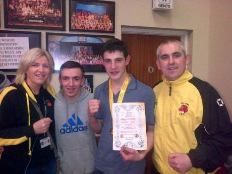 Leon Gallagher celebrates his Ulster final win earlier in the year with Finn Valley ABC members Sharon Scanlon, Darren Kelly, and club coach Billy Quigley.