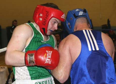 Ryan Mc Cullagh of Raphoe BC in action against James Bonner of Dungloe BC.
