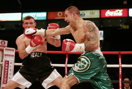 John Hutchinson lands a straight right on Gerard Healy. Hutchinson fights for the vacant Irish light middleweight title this weekend in Reading.