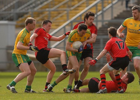 Rory Kavanagh under pressure from three Down men, in the midfield area, in the Div 2 clash in Pairc Esler, Nerwry,