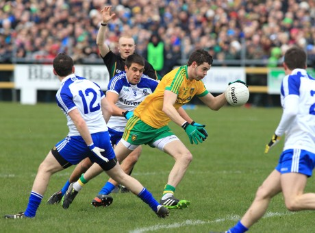 Donegal's Odhrán Mac Niallais breaks through the Monaghan defence to score a goal.