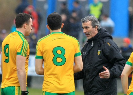 Donegal manager Jim McGuinness giving instructions to midfielders Martin McElhinney (9) and Rory Kavanagh (8) before the Monaghan match in O'Donnell Park. Photo: Donna El Assaad