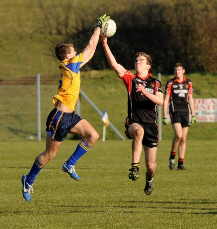 St Eunan's Oisin Carr, rises high with St Michael's Shea Heffron, during their Danske Bank MacLarnon Cup semi-final.