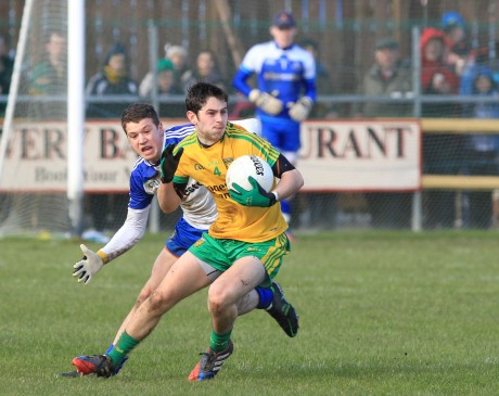 Ryan McHugh, Donegal in action against Ryan Wylie of Monaghan.