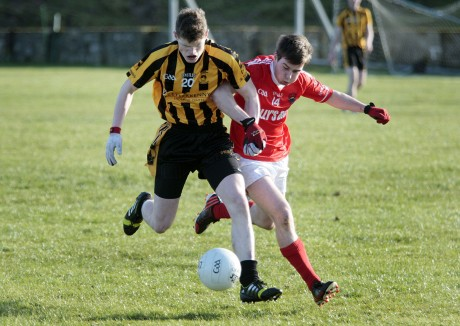 St Eunan's Conor Morrison - still at St Eunan's College - gets to the ball ahead of St. Michael's Lee Martin Carr. Photo: Declan Doherty