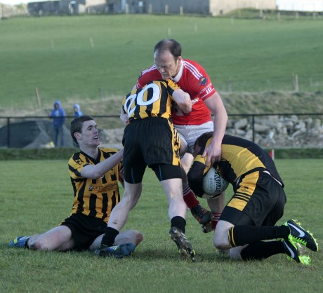 St Eunan's 'keeper John Paul Clarke gathers the ball as Conor Morrison pressures Colm McFadden.