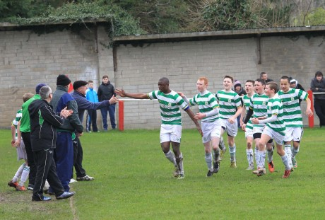 Castlebar Celtic's Thierry Baba celebrates with management and team mates after putting his side ahead during last Saturday's game against Swilly Rovers.