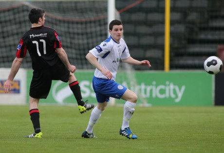 Ciaran Coll of Finn Harps has his eyes on the ball as he clears the danger against Longford Town.