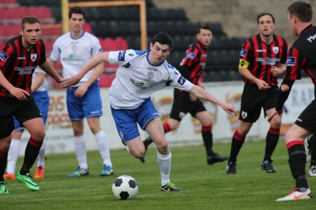 Caoimhin Bonner, making his full debut for Finn Harps, finds himself surrounded by Longford Town players.