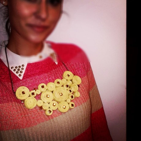 A necklace Zara made from recycled papers.