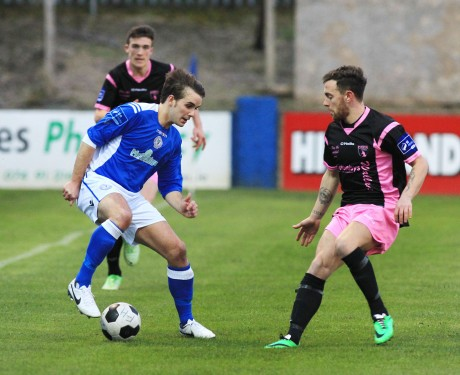 James Doherty of Finn Harps keeps possession against Wexford Youths.