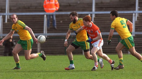 Donegal's Karl Lacey battles with Armagh's Kyle Carragher, as Neil Gallagher and Frank McGlynn support him.