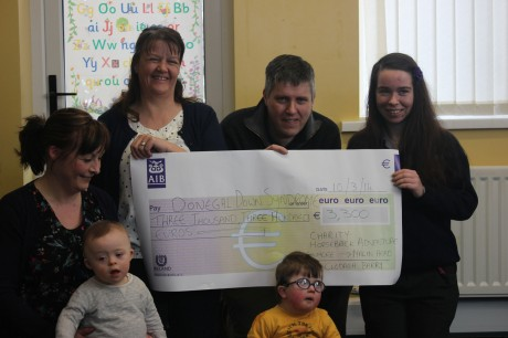 Clodagh Barry (right) presents a cheque for 3300 euro to Gearoid Melvin and Maureen Jordan, Chairman and Secretary of the Donegal Down Syndrome  Association.
