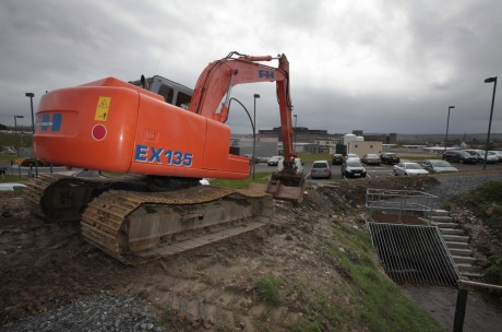 The excavator on standby at the culvert.