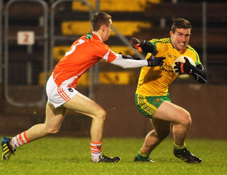 Patrick McBrearty, who scored eight points, rounding Armagh full back Seamus Kelly.