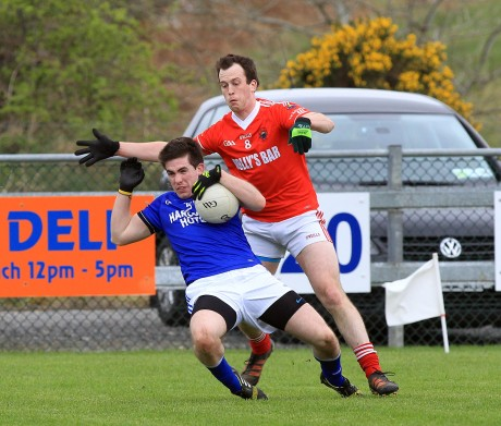 Cathal Ellis, Naomh Conaill under pressure from Michael McGinley, St Michaels. Photo: Donna El Assaad