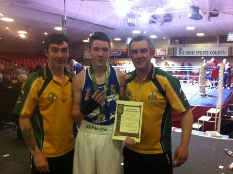 Ryan Greene, with coaches Martin Harkin and Eamonn Duffy, following his win