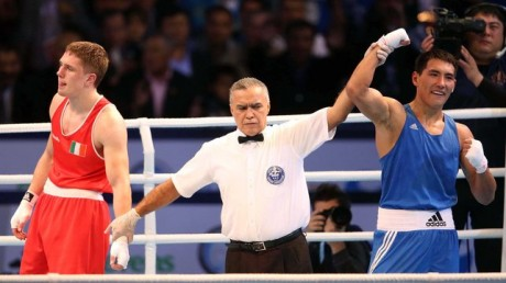 Jason Quigley after his defeat to Zhanibek Alimkhanuly (right)