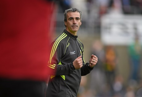 Donegal manager Jim McGuinness clenches his fists in celebration at the final whistle.