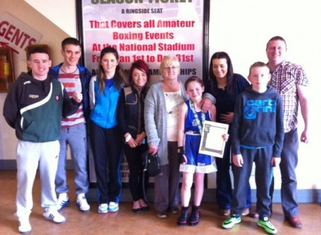 Raphoe's Cody Lafferty with family and friends after winning the Girl 1 title on Saturday