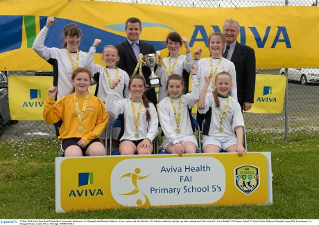 Girls from Scoil Cholmcille, Greencastle, Innisowen with Damien Flaherty, Aviva, centre, and Alex Harkin, FAI Schools, celebrate with the cup after winning the Girl's section B. Aviva Health FAI Primary School 5's Ulster Finals, Ballyare, Donegal League HQ, Letterkenny. Photo: Oliver McVeigh / SPORTSFILE