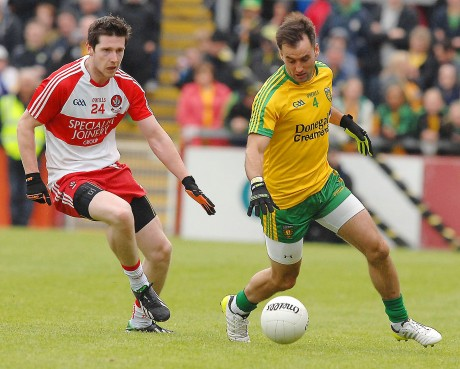 Karl Lacey, winning the ball from Derry's Emmet Bradley.