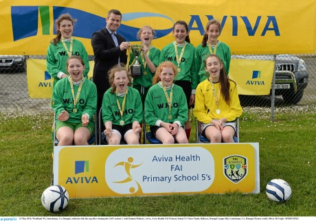 Woodland NS, Letterkenny celebrate with the cup after winning the Girl's section 1, with Damien Flaherty, Aviva. Aviva Health FAI Primary School 5's Ulster Finals, Ballyare, Donegal League HQ, Letterkenny. Photo: Oliver McVeigh / SPORTSFILE