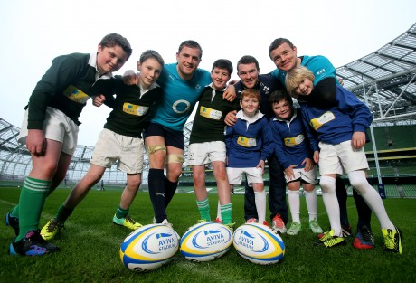 Jamie Heaslip, Peter O'Mahony and Brian O'Driscoll with some children who will be participating in the event. Photo: NPHO/Donall Farmer