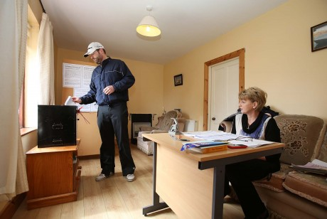 Patrick Sweeney casting his vote on Gola Island yesterday (Thursday). Included is polling officer Nancy Sharkey.