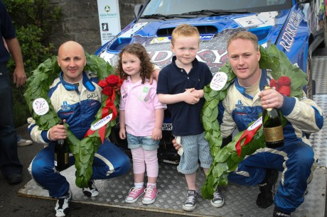 Ronan and Jesica Boyle enjoy the celebration with Declan and Brian Boyle as overall winners  at the finishing ramp of the Donegal International Rally . Photo Cristeph/Brian McDaid