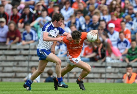 Caolan McConville, Armagh, in action against Caolan McElwain, Monaghan.