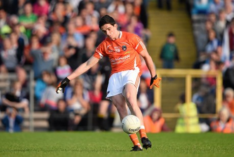 Rory Grugan, Armagh, kicks a point from a free in the last seconds to equalise the game and send it to a replay.