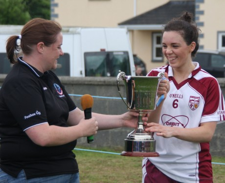 Termon captain Therese McCafferty receives the All-Ireland Gaeltacht Cup in Moycullen