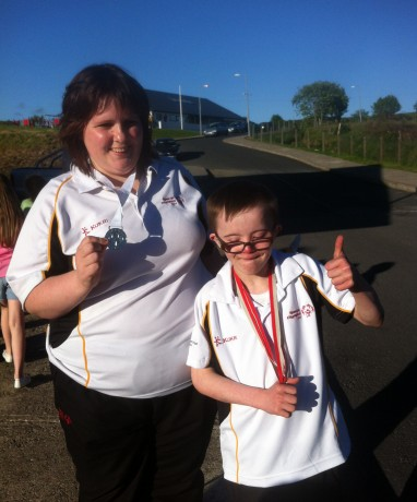 Marian Gallagher and Kyle Glackin with their medals at the homecoming in Glenfin on Tuesday evening
