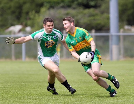 Gaoth Dobhair's Kevin Cassidy challenges against Gareth Concarr of Ardara. Photo: Donna El Assaad