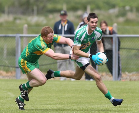 Odhran MacNiallais, Gaoth Dobhair is challenged by Stephen McHugh, Ardara. Photo by Donna El Assaad