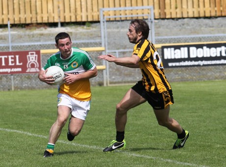 David O'Herlihy, St Eunans closes in on Darren McGinley, Glenswilly. Photo: Donna El Assaad