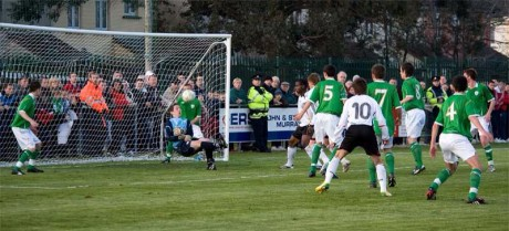 Ciaran Gallagher makes a save for the Republic of Ireland Under-16s against Germany in 2008. Mario Gotze (10) looks on.