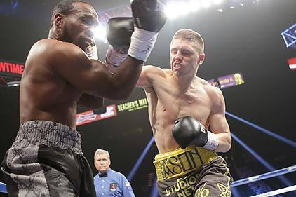 Jason Quigley lets fly against Howard Reece