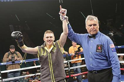 Jason Quigley's hand is raised in victory by referee Jay Nada