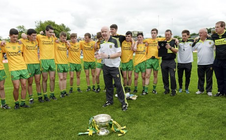 Declan Bonner, Donegal minor manager, addresses his players after the Ulster final.