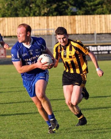 Conor Gibbons, St Eunan's closes in on Four Master's Caolan Loughney.