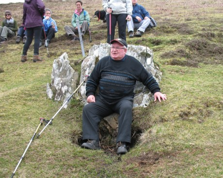 Local Colmcille Guide Paddy 'Beag' Mac Giolla Easbuig on the seat of Colm Cille.