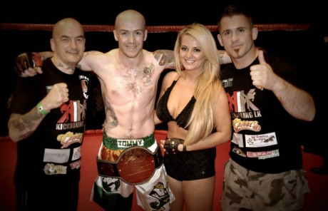 Tommy with coaches China Coyle and Marty McLaughlin after winning the Chaos Fighting Championship Featherweight title.